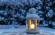 Lantern in garden, winter evening