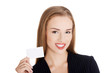 Young business woman holding small personal card.