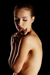Sensual portrait of nude woman on dark background
