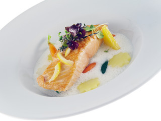 fried salmon with vegetables in frothy lemon sauce