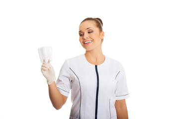 Female dentist holding a tooth model