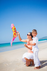 Boy with his mother flying kite