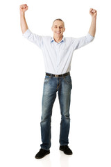 Cheerful man with hands up