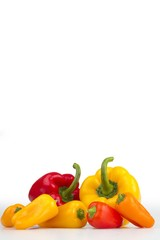 Colourful peppers white background