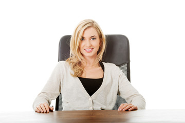 Happy woman sitting at the desk