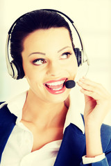 Happy smiling support phone operator in headset.