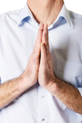 Male hands clenched to pray