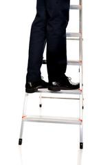 Close up male legs climbing ladder