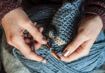 close up of hands crocheting
