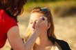 woman face applying eyeshadow eyes makeup.