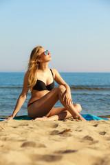 Summer vacation Girl in bikini sunbathing on beach