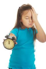 Little girl holding alarm clock