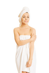 Beautiful woman wrapped in towel