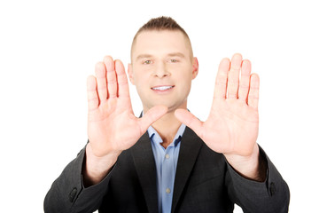 Businessman gesture stop sign with his hands