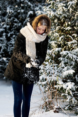 Young woman making snowball