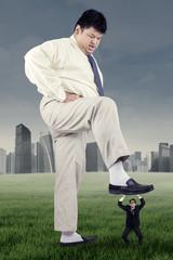 Big male worker treading an employee