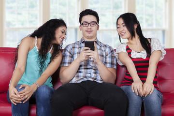 Caucasian man with curious girls