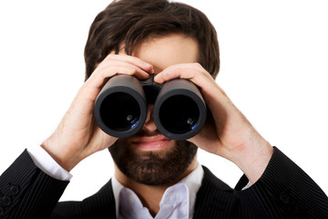Young businessman with binoculars.