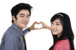 Couple showing heart shape with hands