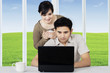Couple surfing internet online on laptop