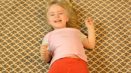 Happy Child Lying on a Carpet, Crazy Emotions