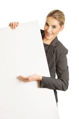 Businesswoman holding empty billboard