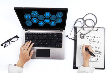 Doctor with prescription and laptop