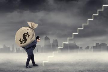 Entrepreneur carry a money bag to the sky