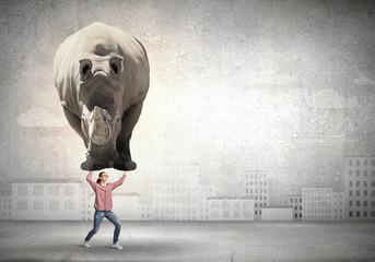 Girl lifting rhino