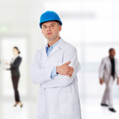 Man in a lab coat and helmet