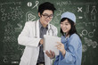 Two doctors with digital tablet