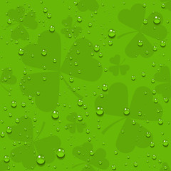 Green seamless clover leaves with transparent drops of dew