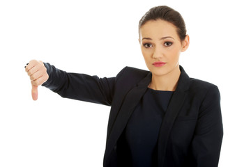 Severe businesswoman with thumb down.