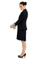 Businesswoman with handcuffs.