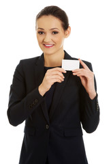 Businessswoman holding empty card.