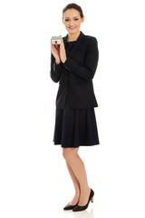 Businesswoman holding house model.