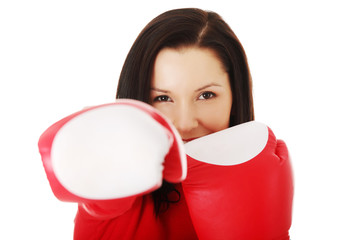 Attractive woman wearing boxing gloves.