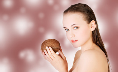 Spa woman with coconut.