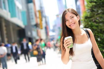 Tokyo city woman commuter walking drinking coffee