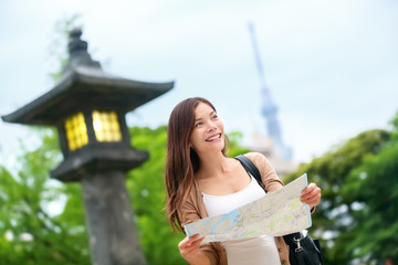 Travel in Tokyo - Asian tourist woman with map