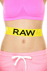 Raw food diet concept - closeup of woman's stomach
