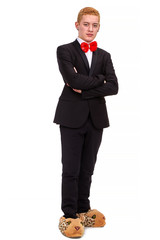 Serious businessman with a funny bowtie and animal slippers in a