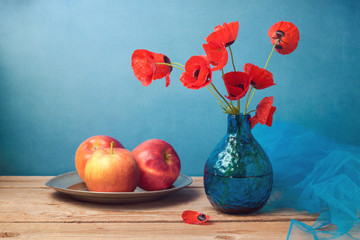Retro still life with poppies and apples