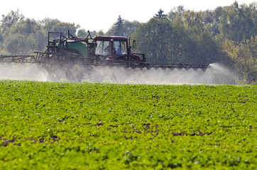 Tractor spray fertilize  with insecticide herbicide in field