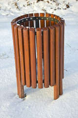 wooden new rubbish bin box on snow