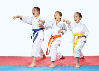 Punch hands forward are beating sportsmens in karategi