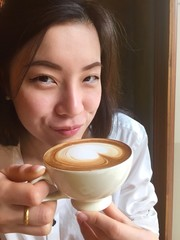 girl drink hot coffee