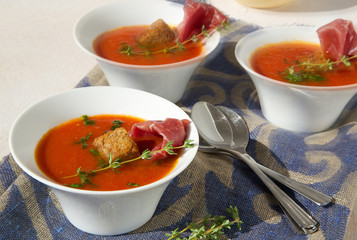 Tomato cream soup with bresaola and thyme