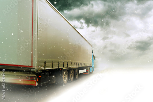 canvas print picture Speeding truck on Snowy road
