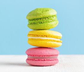 Colorful macaron on a white wooden table